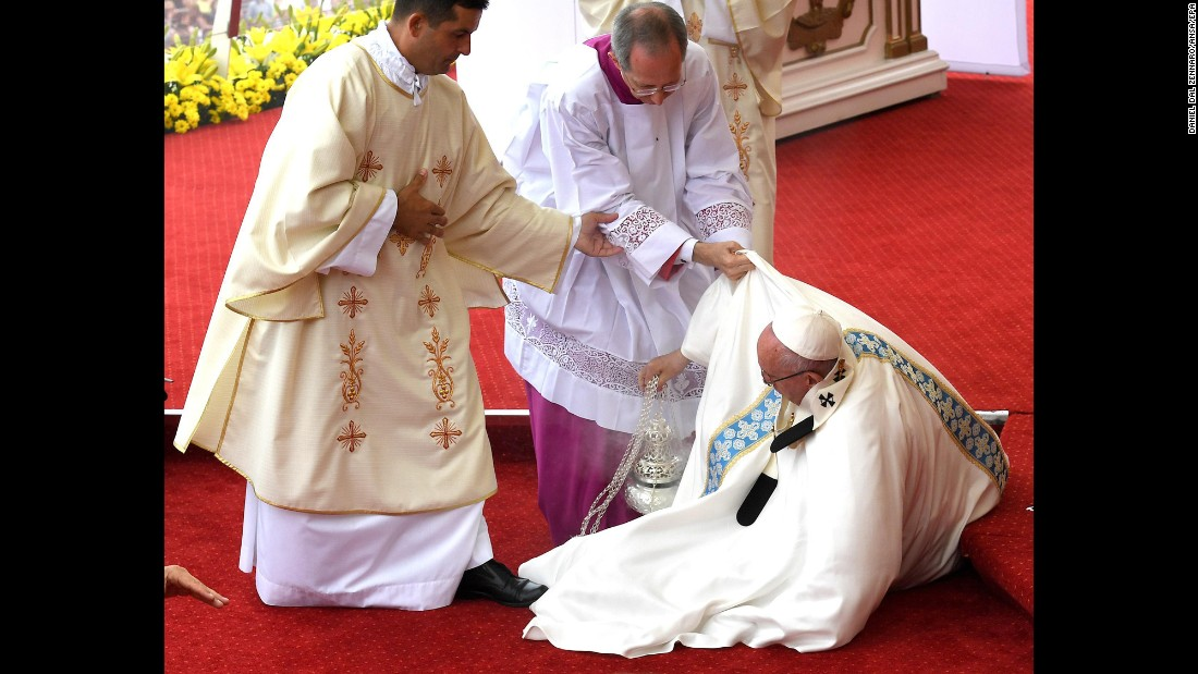 """Pope Francis stumbles on a step while <a href=""""http://www.cnn.com/2016/07/28/europe/pope-francis-poland-krakow/index.html"""" target=""""_blank"""">leading an outdoor Mass</a> in Czestochowa, Poland, on Thursday, July 28. He was helped up quickly by members of the clergy, and the service continued without interruption."""