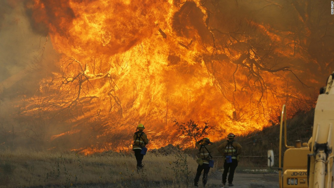 "A hillside erupts in flames as a raging wildfire fire burns in Santa Clarita, California, on Monday, July 25. The Sand Fire <a href=""http://www.cnn.com/2016/07/26/us/california-wildfires/"" target=""_blank"">has forced thousands from their homes</a> on the edge of Los Angeles."