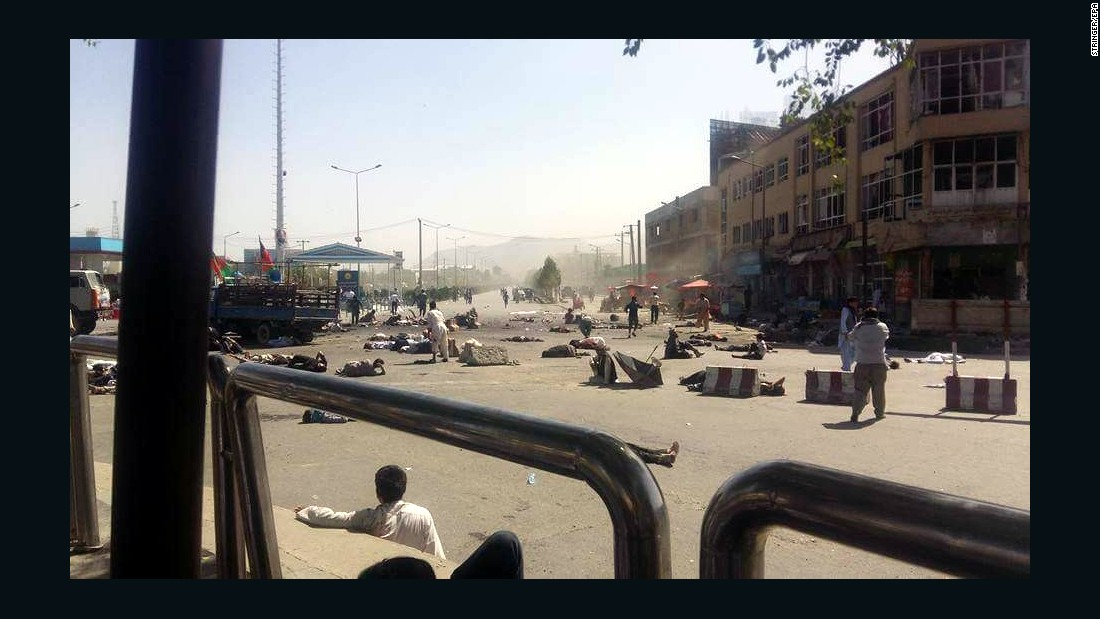 "Injured people lie on the ground after a bomb exploded during a peaceful demonstration in Kabul, Afghanistan, on Saturday, July 23. <a href=""http://www.cnn.com/2016/07/23/asia/afghanistan-explosion/"" target=""_blank"">ISIS claimed responsibility</a> for a joint suicide bombing that killed dozens of people and wounded more than 260."