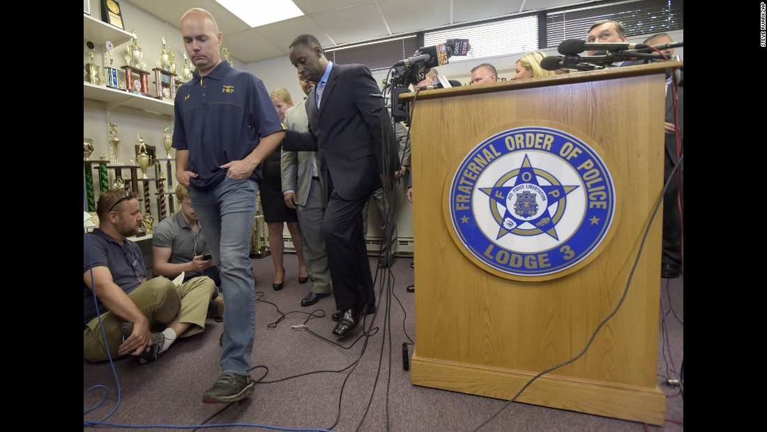 """Baltimore Police Lt. Brian Rice, left, leaves a news conference Wednesday, July 27, after <a href=""""http://www.cnn.com/2016/07/27/us/freddie-gray-verdict-baltimore-officers/index.html"""" target=""""_blank"""">charges were dropped</a> against him and other police officers who were awaiting trial in the case of Freddie Gray. Gray died of a severe spinal-cord injury while in police custody last year. Three officers were acquitted in the case before prosecutors dropped the charges against the remaining three on Wednesday."""