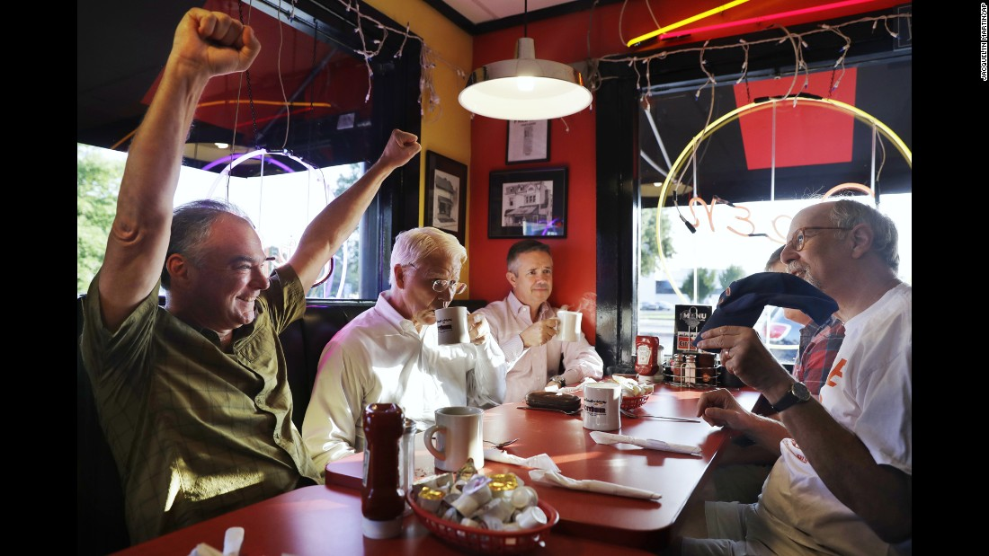 "U.S. Sen. Tim Kaine, left, talks sports with friends during breakfast in Richmond, Virginia, on Tuesday, July 26. Kaine had recently been named <a href=""http://www.cnn.com/2016/07/22/politics/hillary-clinton-vp-pick/"" target=""_blank"">Hillary Clinton's running mate</a> on the Democratic ticket."