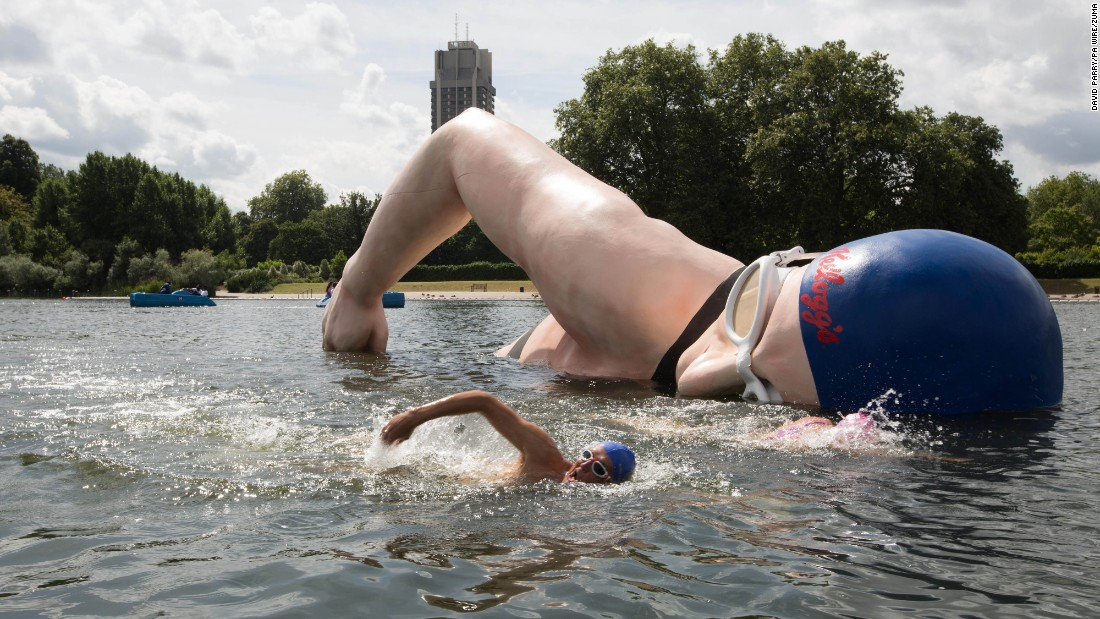 "George Cselko swims past a sculpture of British swimming champion Rebecca Adlington after it was unveiled in London's Hyde Park on Monday, July 25. The sculpture is part of a campaign to encourage support for Great Britain's Olympic athletes. <a href=""http://www.cnn.com/2016/07/22/world/gallery/week-in-photos-0722/index.html"" target=""_blank"">See last week in 33 photos</a>"