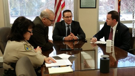 From left, Tulare County Sheriff's Captain Cheri Lehner, Undersheriff Robin Skiles, Sheriff Mike Boudreaux and State Assemblyman Devon Mathis, discuss the nut theft problem.