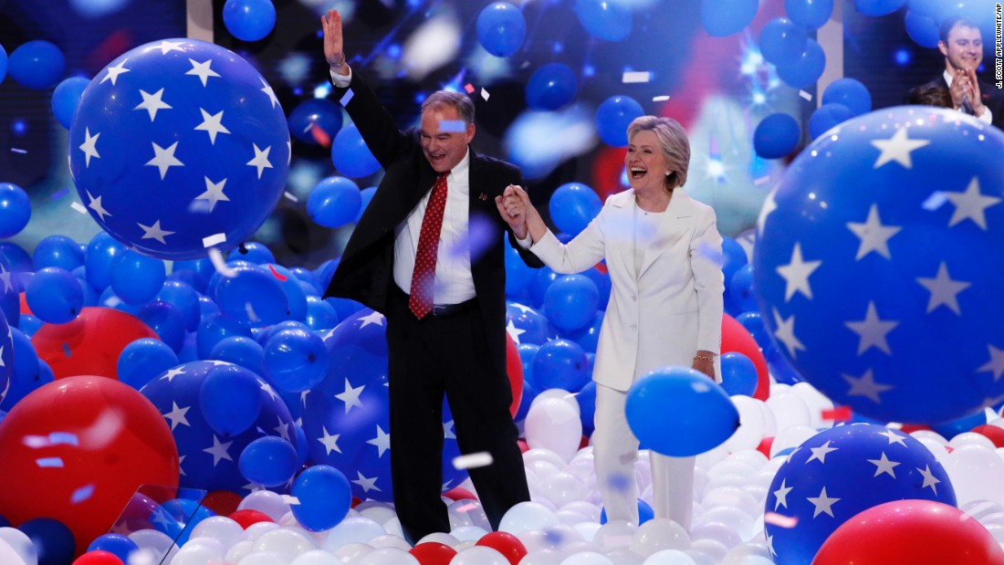 Clinton walks on stage with her running mate, U.S. Sen. Tim Kaine.