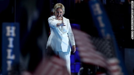 Democratic presidential candidate Hillary Clinton acknowledges the crowd after delivering a speech on the fourth day of the Democratic National Convention at the Wells Fargo Center, July 28, 2016 in Philadelphia, Pennsylvania. Democratic presidential candidate Hillary Clinton received the number of votes needed to secure the party's nomination. An estimated 50,000 people are expected in Philadelphia, including hundreds of protesters and members of the media. The four-day Democratic National Convention kicked off July 25.