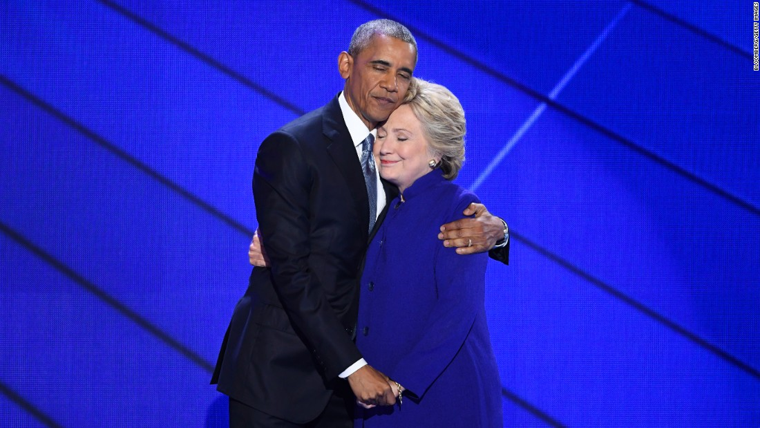 "U.S. President Barack Obama hugs Hillary Clinton after speaking at the Democratic National Convention on Wednesday, July 27. Obama told the crowd at Philadelphia's Wells Fargo Center that Clinton is ready to be commander in chief. ""For four years, I had a front-row seat to her intelligence, her judgment and her discipline,"" he said, referring to Clinton's stint as secretary of state."
