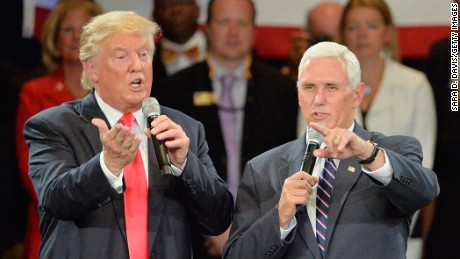 Republican presidential candidate Donald Trump (L) and Republican vice presidential candidate Mike Pence take questions from the audience during a town hall style campaign stop at the The Hotel Roanoke & Conference Center on July 25, 2016 in Roanoke, Virginia. Trump is campaigning with a bump in the polls following the Republican National Convention where he accepted the party's nomination.