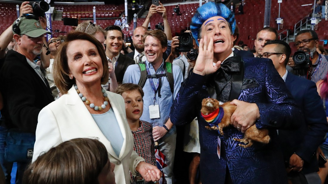 House Minority Leader Nancy Pelosi meets with talk show host Stephen Colbert as he records a segment Sunday, July 24, at the site of the Democratic National Convention.