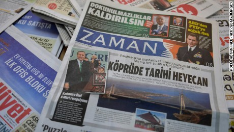 A photo taken in Ankara on March 6, 2016 shows the front page of the first new edition of the Turkish daily newspaper Zaman, which had staunchly opposed the president, now with articles supporting the government since its seizure by authorities.