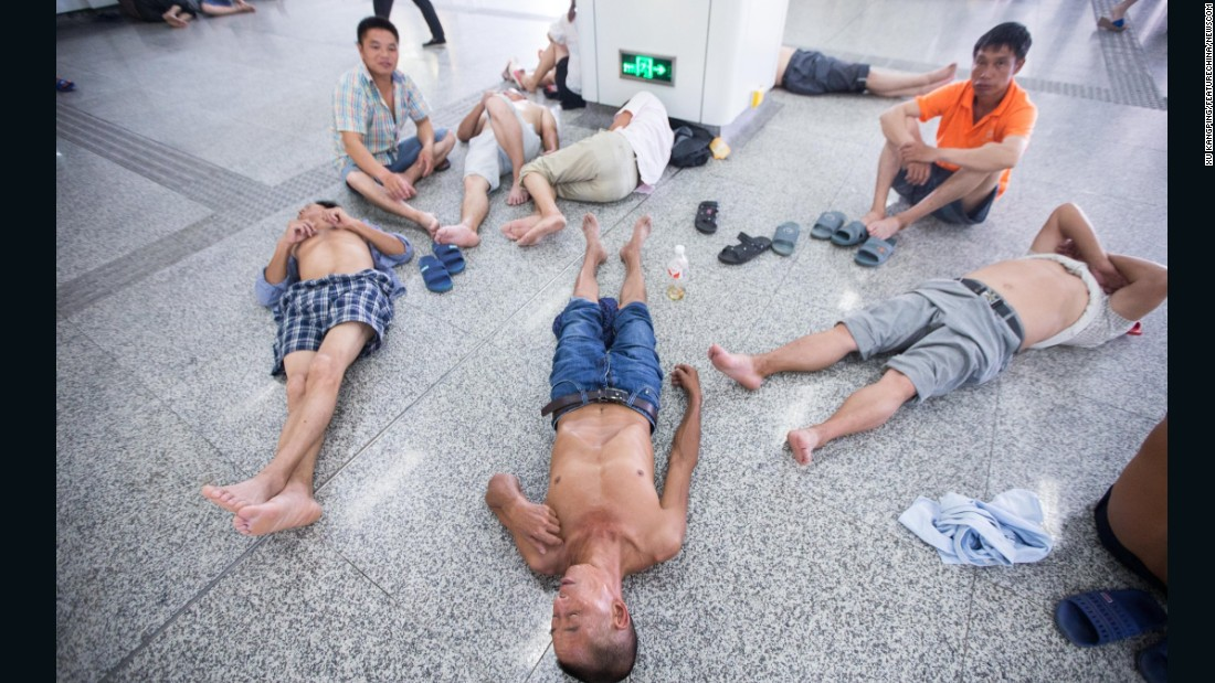 People trying to beat the heat rest an air-conditioned subway station in Hangzhou, China, on Sunday, July 24.