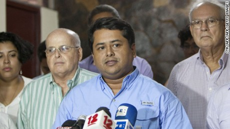 Deputy Wilber Lopez, surrounded by other dispossessed deputies, speaks to the press after 28 opposition deputies were dismissed by the Electoral Tribunal of Nicaragua, in Managua, on July 29, 2016. Nicaraguan opposition was stripped of its seats in Parliament by a resolution of the electoral tribunal, which will allow the party of President Daniel Ortega strengthen its control of the state apparatus, analysts said. / AFP / STR        (Photo credit should read STR/AFP/Getty Images)