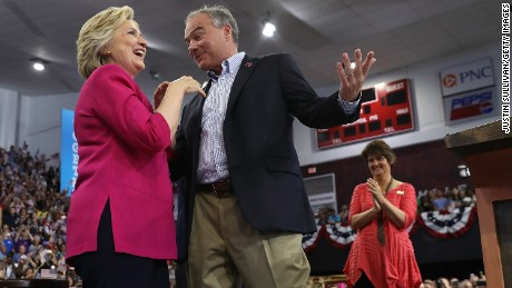 Democratic presidential nominee former Secretary of State Hillary Clinton (R) and democratic vice presidential nominee U.S. Sen. Tim Kaine (D-VA) greet supporters during a campaign rally at Temple University on July 29, 2016 in Philadelphia, Pennsylvania.