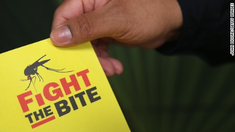 MCALLEN, TX - APRIL 14:  A city environmental health worker displays literature to be distrubuted to the public on April 14, 2016 in McAllen, Texas. Health departments, especially in areas along the Texas-Mexico border, are preparing for the expected arrival of the Zika Virus, carried by the aegypti mosquito, which is endemic to the region. The U.S. Centers for Disease Control (CDC), announced this week that Zika is the definitive cause of birth defects seen in Brazil and other countries affected by the outbreak.  (Photo by John Moore/Getty Images)