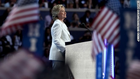 PHILADELPHIA, PA - JULY 28:  Democratic presidential nominee Hillary Clinton acknowledges the crowd as she arrives on stage during the fourth day of the Democratic National Convention at the Wells Fargo Center, July 28, 2016 in Philadelphia, Pennsylvania. Democratic presidential candidate Hillary Clinton received the number of votes needed to secure the party's nomination. An estimated 50,000 people are expected in Philadelphia, including hundreds of protesters and members of the media. The four-day Democratic National Convention kicked off July 25.  (Photo by Jessica Kourkounis/Getty Images)