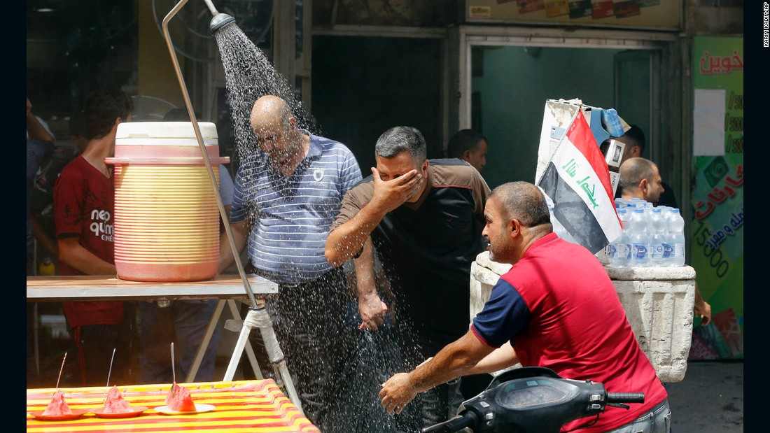 People cool off from the summer heat in Baghdad, Iraq, on Wednesday, July 20.