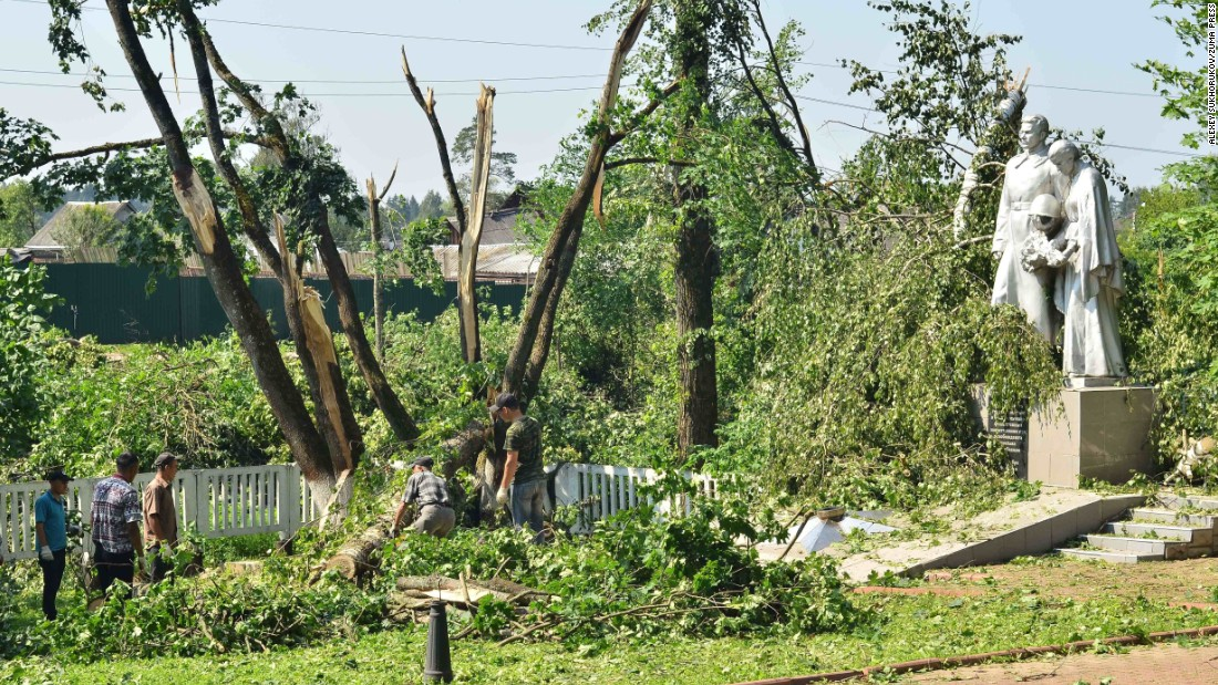 Trees downed by high winds are seen in the village of Kolyubakino, Russia, on Sunday, July 17.