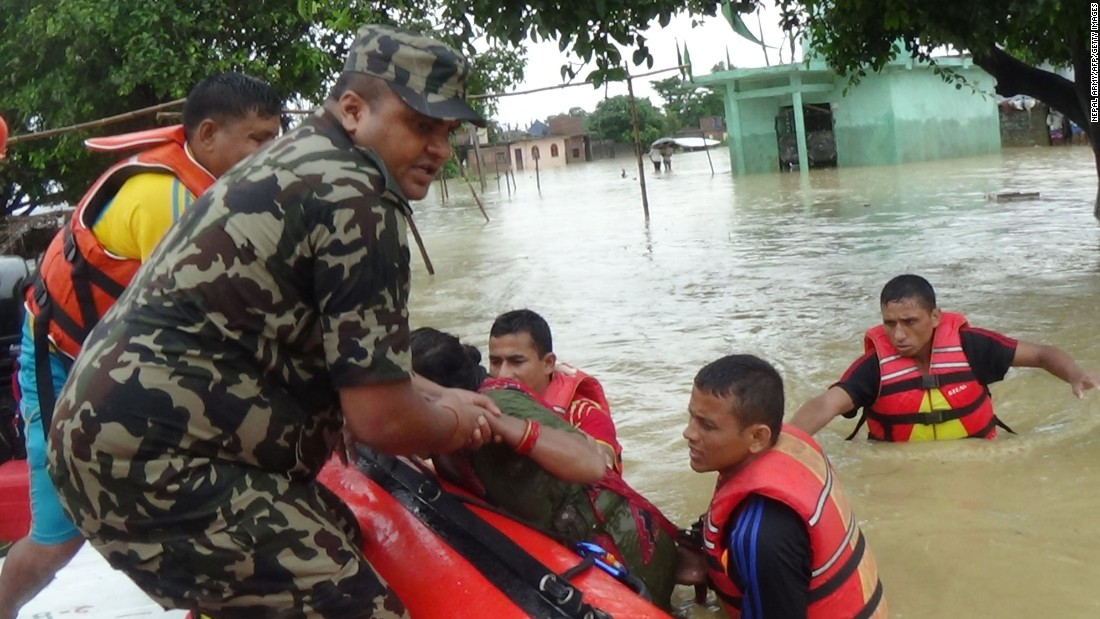 Army personnel rescue flood victims in Nepal's Nawalparasi District on Tuesday, July 26.