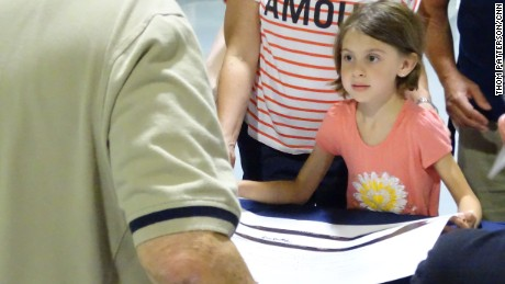 A young visitor at Saturday's event asks an ex-crew member to sign her Blackbird poster.