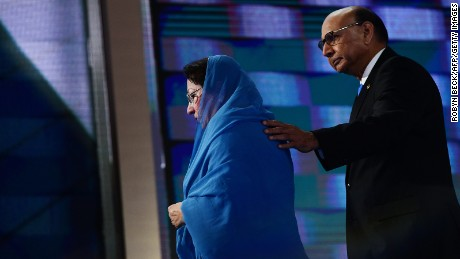 Khizr Khan (R), accompanied by his wife Ghazala Khan (L), walks off stage after speaking about their son US Army Captain Humayun Khan who was killed by a suicide bomber in Iraq 12 years ago, on the final night of the Democratic National Convention at the Wells Fargo Center, July 28, 2016 in Philadelphia, Pennsylvania.