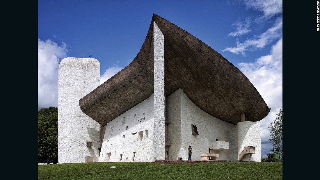 The chapel was built on a pre-existing pilgrimage site. The curved roof demonstrates Le Corbusier's mastery of concrete.