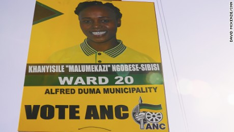 Khanyisile Ngobesi-Sibisi's election poster still hangs in the street where she was killed, days later