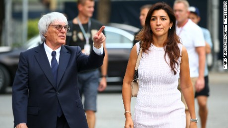 Formula One chief Bernie Ecclestone with his wife, Fabiana Flosi, in Singapore in 2014.