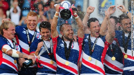 Great Britain Royals captain Luke Treharne lifts the trophy after beating France in the final of the Rugby Europe Sevens event in Exeter.