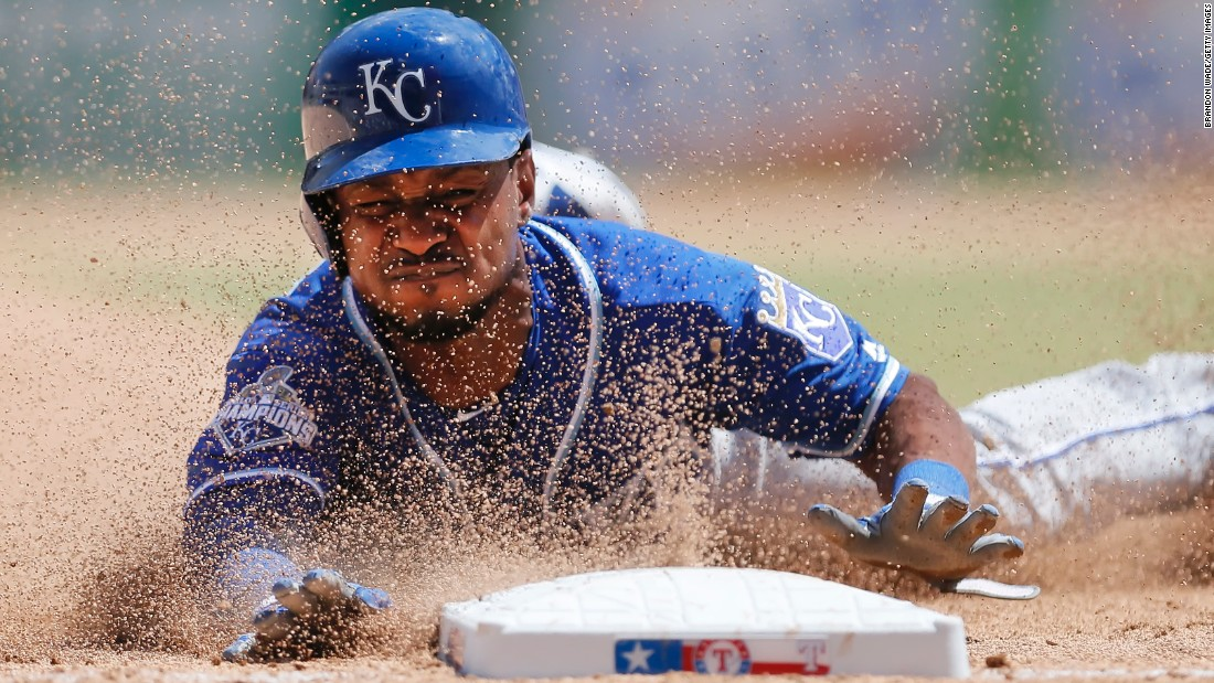 Kansas City's Jarrod Dyson steals third during a Major League Baseball game in Arlington, Texas, on Sunday, July 31.