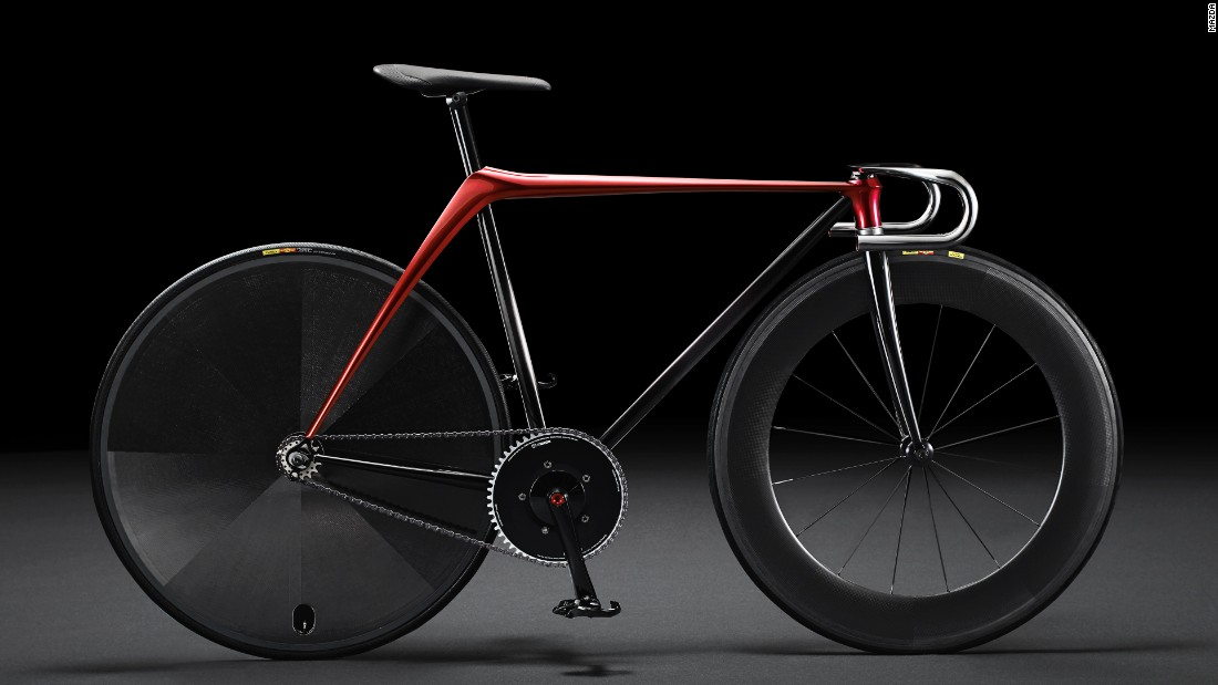 "Japanese car giant Mazda unveiled its ""Bike by KODO concept"" at the 2015 Milan Design Week. The track bike is composed of the least possible parts, according to Mazda, For instance, the frame is hammered out of one piece of metal."