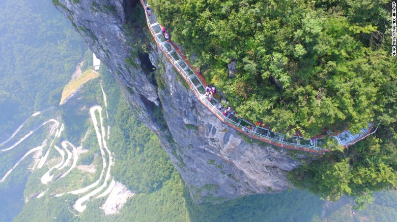 Don't look down: Glass walkway hugs mountain in China
