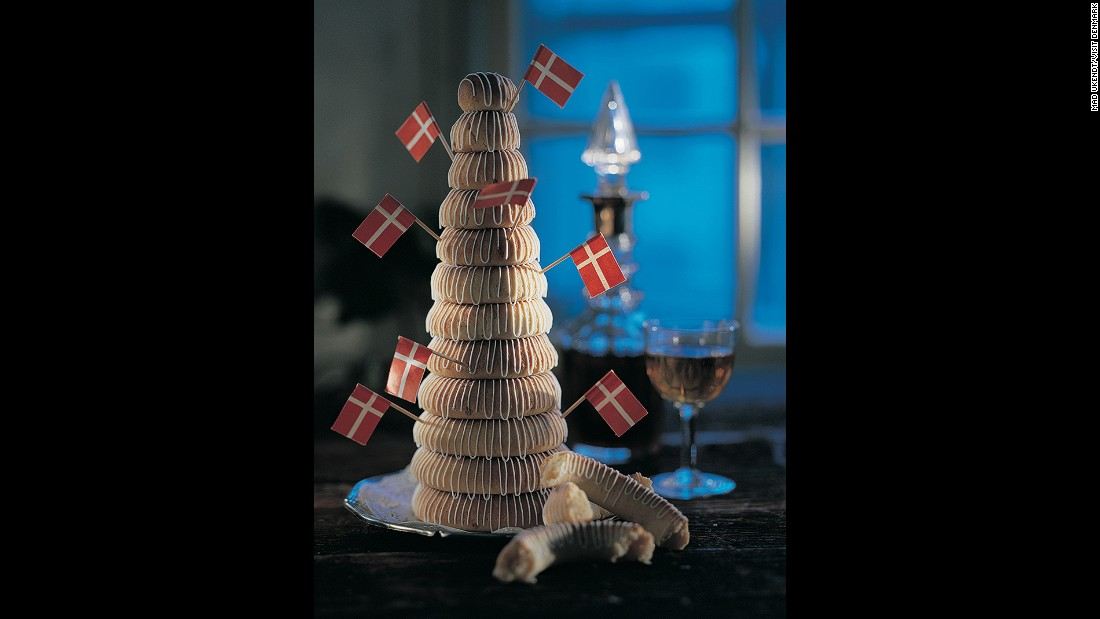 Kransekage in Danish (or kransekake in Norwegian) is composed of differently sized ring cakes, made with ground almonds, arranged in a stack.