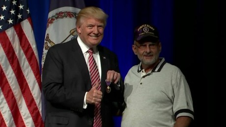 Donald Trump receives Purple Heart from veteran