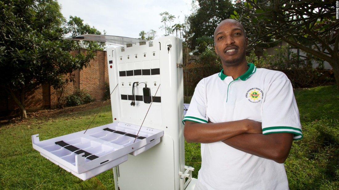 Solar energy innovator Henri Nyakarundi with his portable mobile charging kiosk in Rwanda.