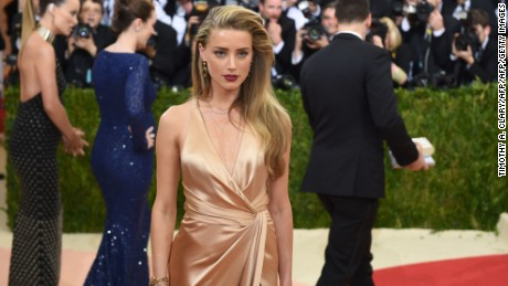 Amber Heard arrives for the Costume Institute Benefit at The Metropolitan Museum of Art May 2, 2016 in New York. / AFP PHOTO / TIMOTHY A. CLARYTIMOTHY A. CLARY/AFP/Getty Images