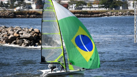 A crew from Brazil heads out through the breakwater to a training session.