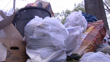 Garbage piles up after Flint fails to reach a long-term trash agreement.