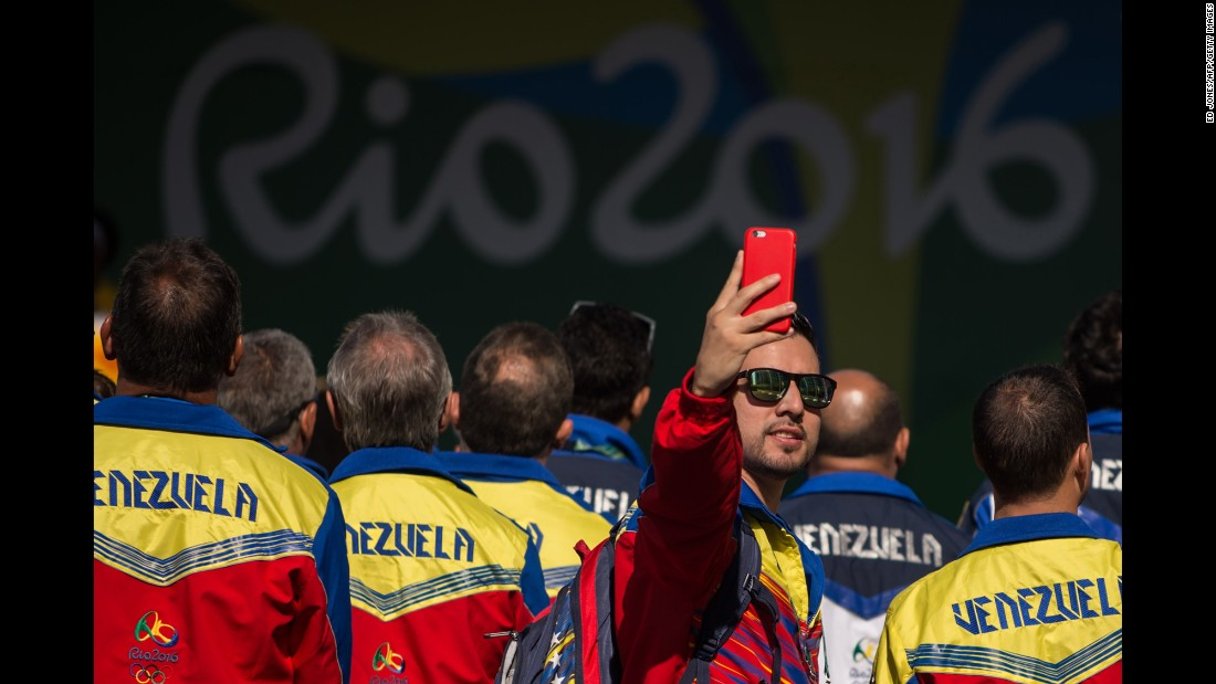 A member of Venezuela's Olympic team takes a selfie during a welcoming ceremony at the Olympic Village on August 2.