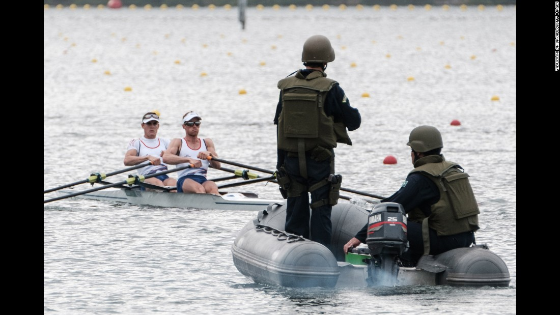 Brazilian Marines patrol the water as rowing teams practice in Rio on Friday, July 29.