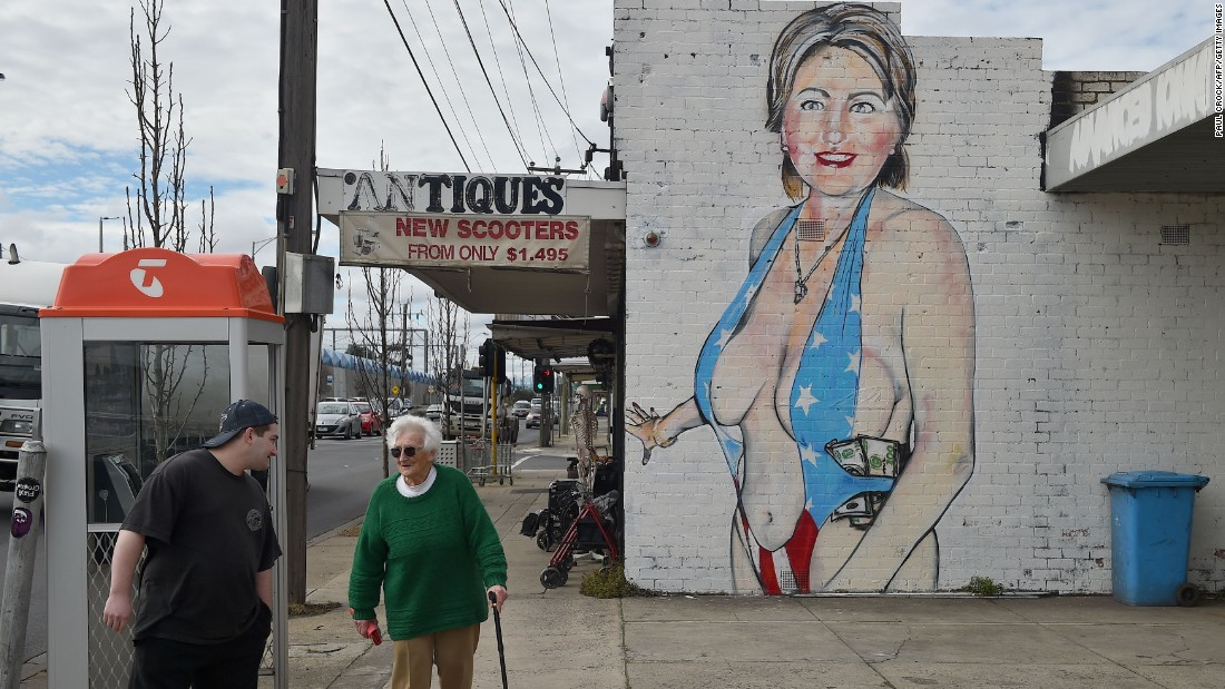 Artist gives provocative hillary clinton mural a burqa for America today mural