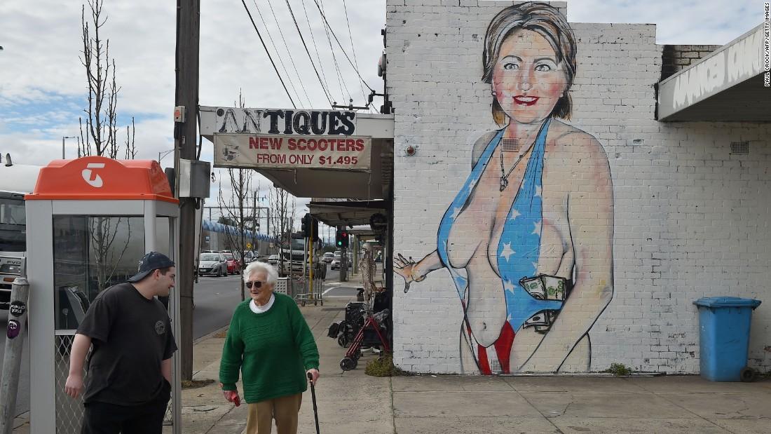 Artist gives provocative hillary clinton mural a burqa for Australian mural artists