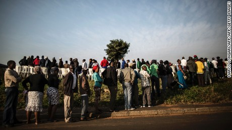 South African voters stand in line at a polling station in Durban on Wednesday.