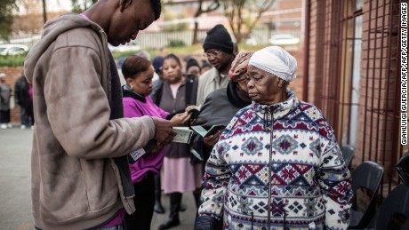 South African voters show their IDs before voting Wednesday in municipal elections in Johannesburg.