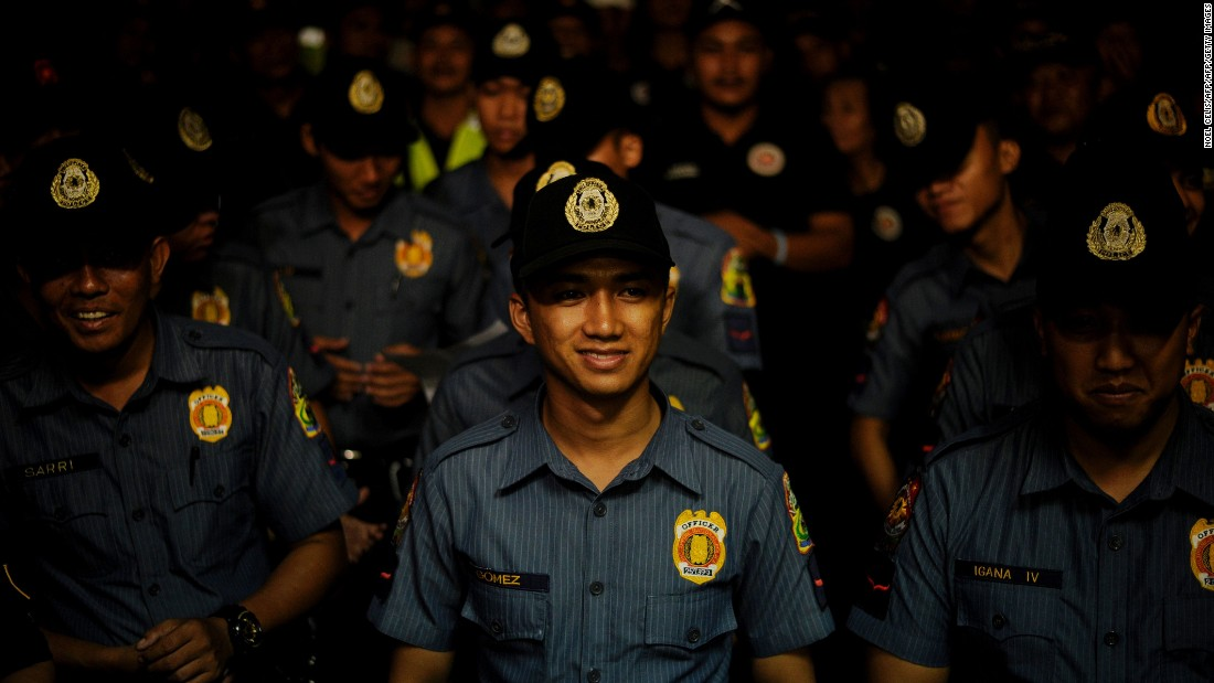 "Police officers stand in formation before the start of ""Oplan Rody"" on June 1, 2016, a law enforcement operation named after President Duterte, whose nickname is Rody."