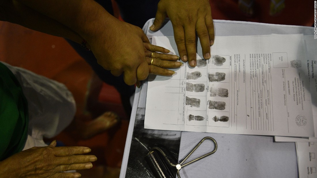 A man authorities accused of being a drug user is fingerprinted during the mass surrender of some 1,000 alleged drug users and pushers in the Philippine town of Tanauan, located about 37 miles (60 kilometers) south of Manila on July 18, 2016.