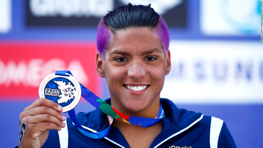 Ana Marcela Cunha's colorful hair will be wrapped under a swimcap when she does battle in Rio. At last year's world championships in Kazan, Russia she won gold in the 25km marathon and a bronze in the 10km as well as a silver medal in the team open water event.<br />