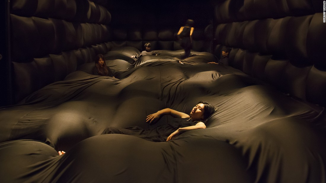 This dark room is filled with soft material that alters according to one's weight.