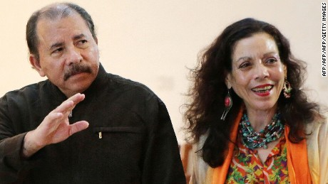 Nicaraguan President, Daniel Ortega and his wife Rosario Murillo wave to journalists on December 4, 2013 in Managua. AFP PHOTO / Inti Ocon / AFP / Inti Ocon        (Photo credit should read INTI OCON/AFP/Getty Images)