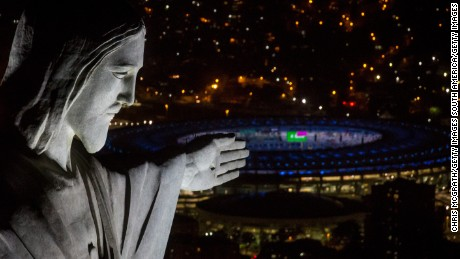 RIO DE JANEIRO, BRAZIL - JULY 31:  The Christ the Redeemer statue is seen at sunset in front of the Maracana Stadium ahead of the 2016 Summer Olympic Games on July 31, 2016 in Rio de Janeiro, Brazil.  (Photo by Chris McGrath/Getty Images)