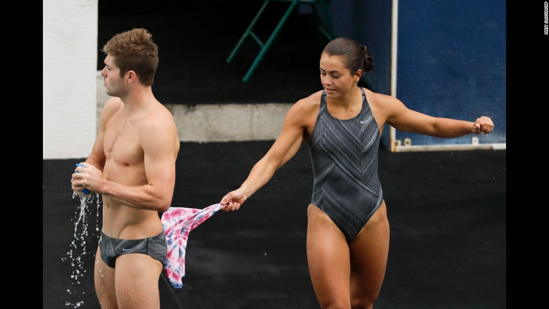 "U.S. diver Kassidy Cook swats teammate Michael Hixon with a wet towel as they train for <a href=""http://www.cnn.com/2016/08/03/sport/gallery/rio-olympics-before-opening-ceremony/index.html"" target=""_blank"">the Olympics</a> in Rio de Janeiro on Wednesday, August 3."