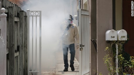 What are mosquito-control workers spraying in Miami?